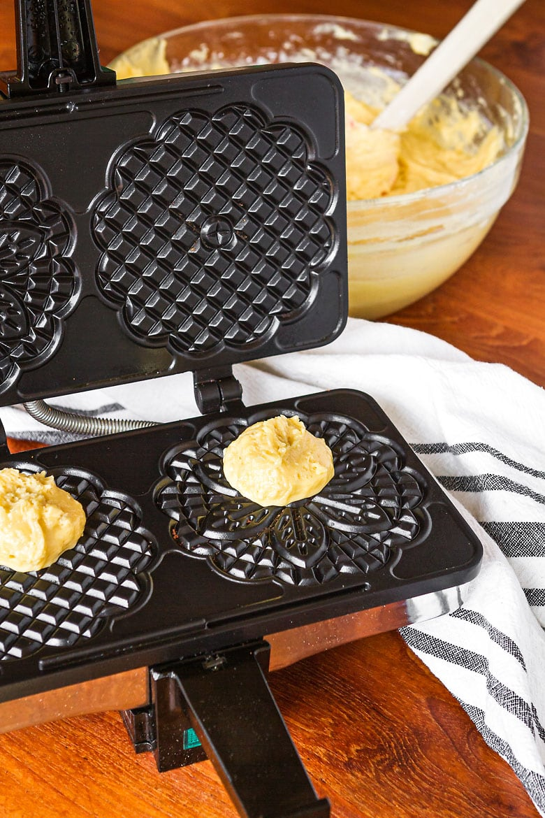 classic pizzelle recipe batter on an electric pizzelle iron