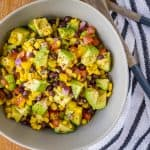 Guacamole Salad -- dressed in a simple lime vinaigrette, this guacamole salad is a fantastic summer side dish… You'll love the combination of creamy avocado, tangy lime, and spicy jalapeño, along with a good measure of sweet corn and black beans! | guacamole salad recipe | healthy guacamole salad | guacamole salad side dish | summer salad | find the recipe on unsophisticook.com