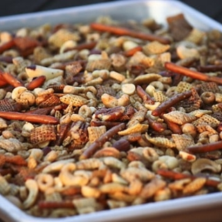 Slow Cooker Chex Mix Recipe -- yes, you can make Chex mix in your slow cooker! And? It's absolutely amazing… perfect for game day get togethers! | unsophisticook.com