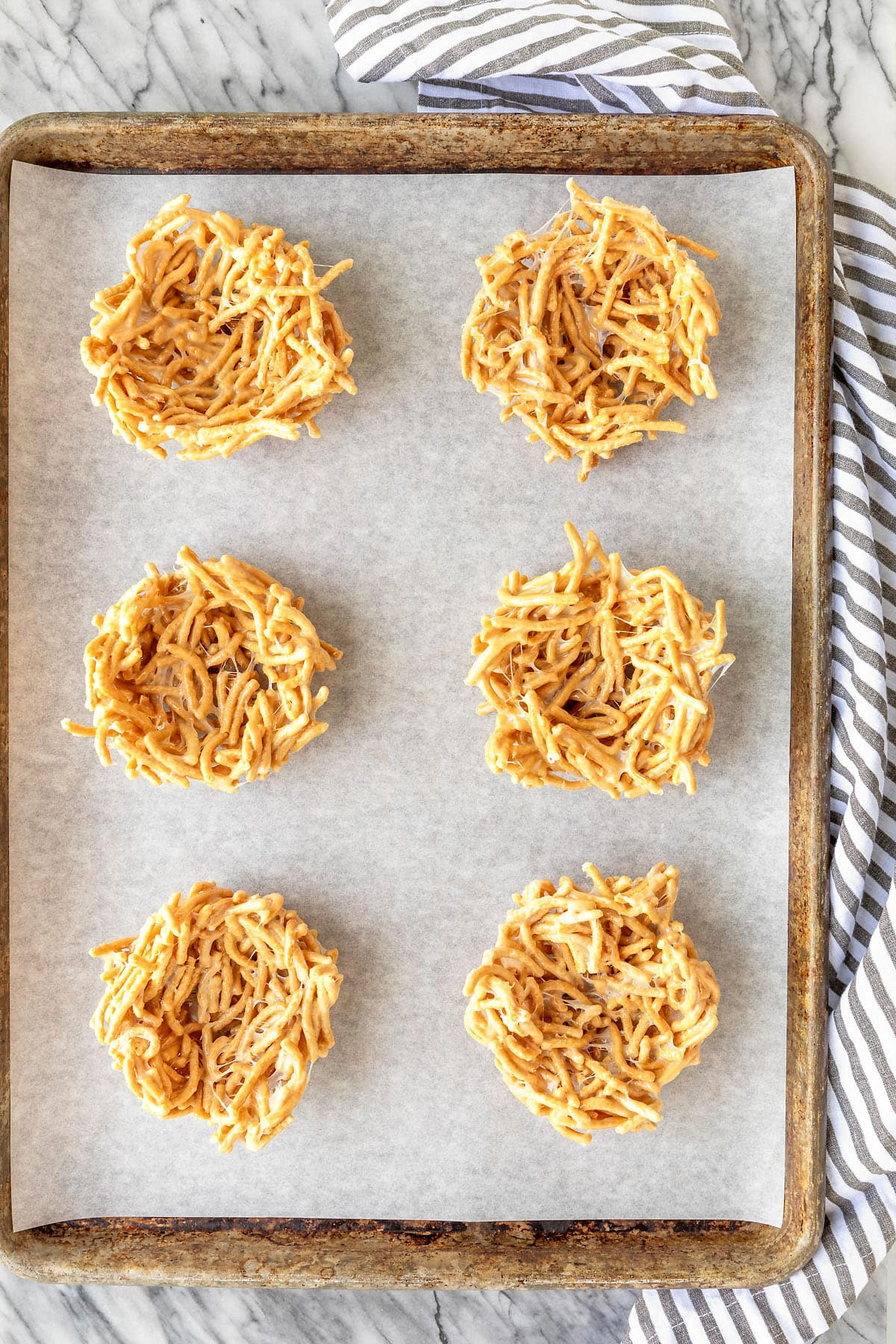 easter haystack nests recipe on a parchment lined sheet pan