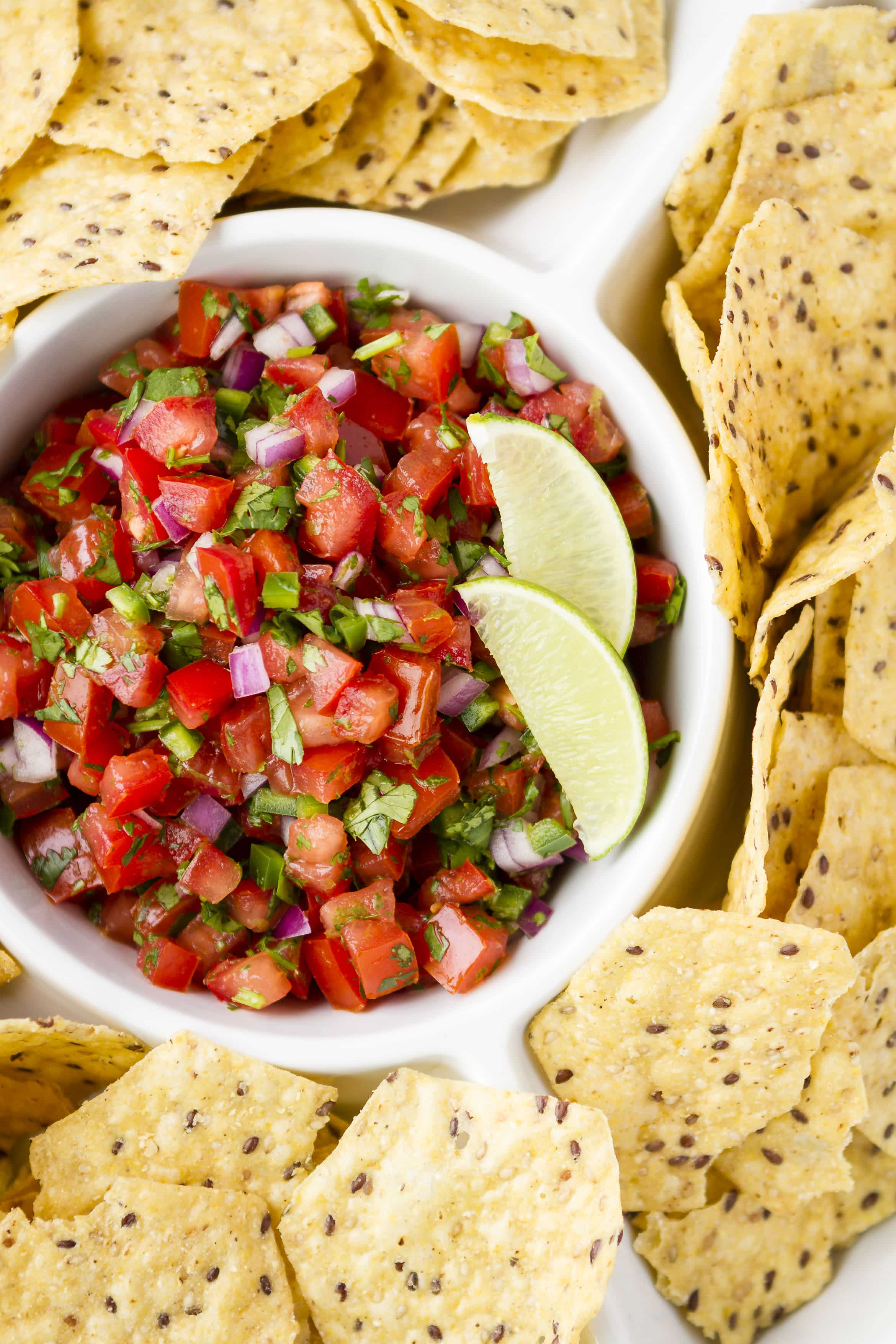 Fresh Tomato Salsa -- sweet, juicy tomatoes, red onion for a little bite, cilantro, lime juice and zest, and a little diced jalapeño pepper, plus a dash of salt are all you need for a deliciously homemade fresh tomato salsa... SO simple and flavorful! | pico de gallo | salsa fresca | fresh tomato salsa recipe | easy fresh tomato salsa | 5 ingredients | find the recipe on unsophisticook.com