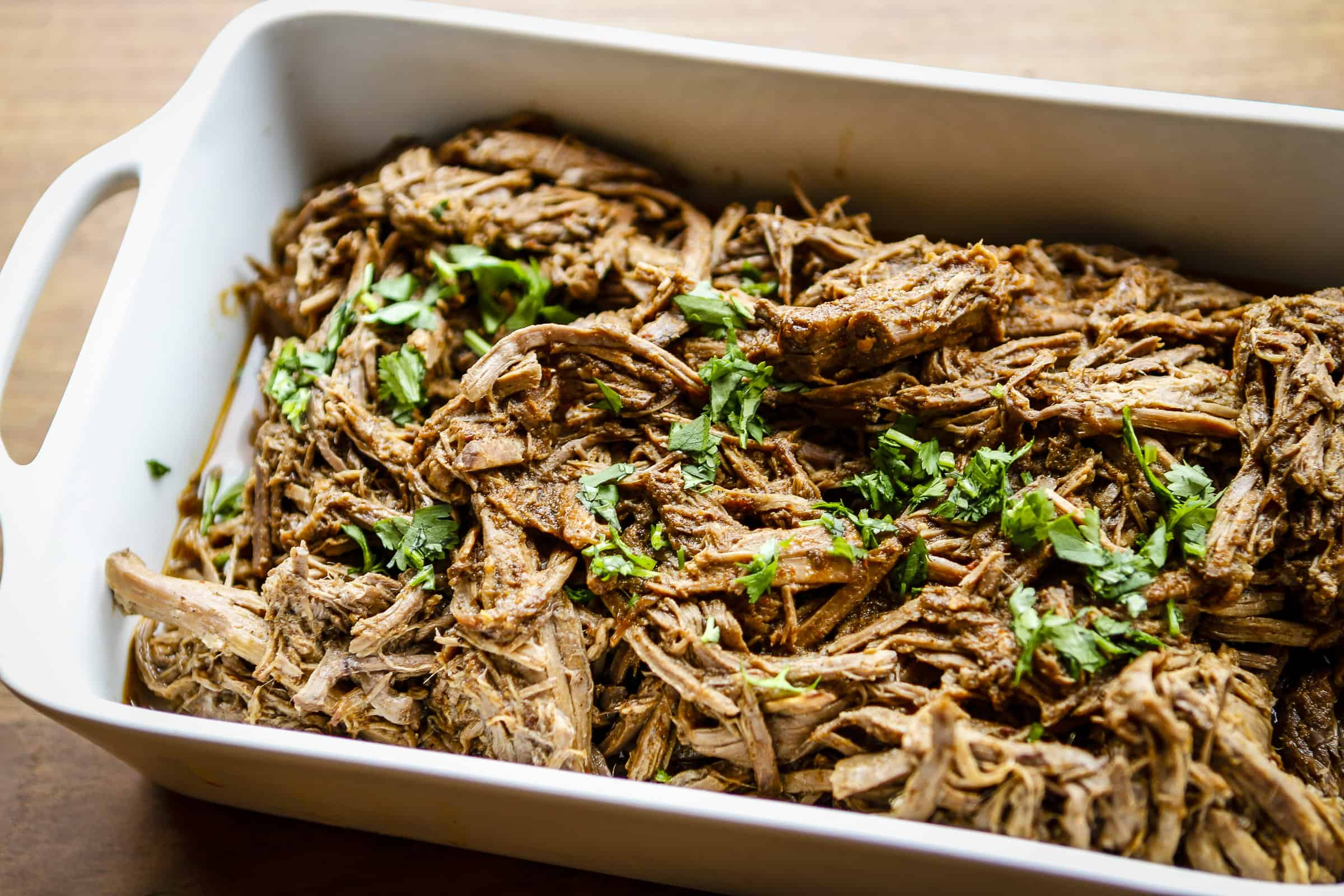 Slow Cooker Beef Barbacoa Recipe -- this copycat Chipotle slow cooker beef barbacoa smells ah-mazing and tastes even better! Perfect for tacos, burrito bowls, tostadas, and so much more. Ideal meal prep recipe! | beef barbacoa crockpot | beef barbacoa slow cooker | barbacoa chipotle | how do you make barbacoa meat | meal prep recipes | find the recipe on unsophisticook.com