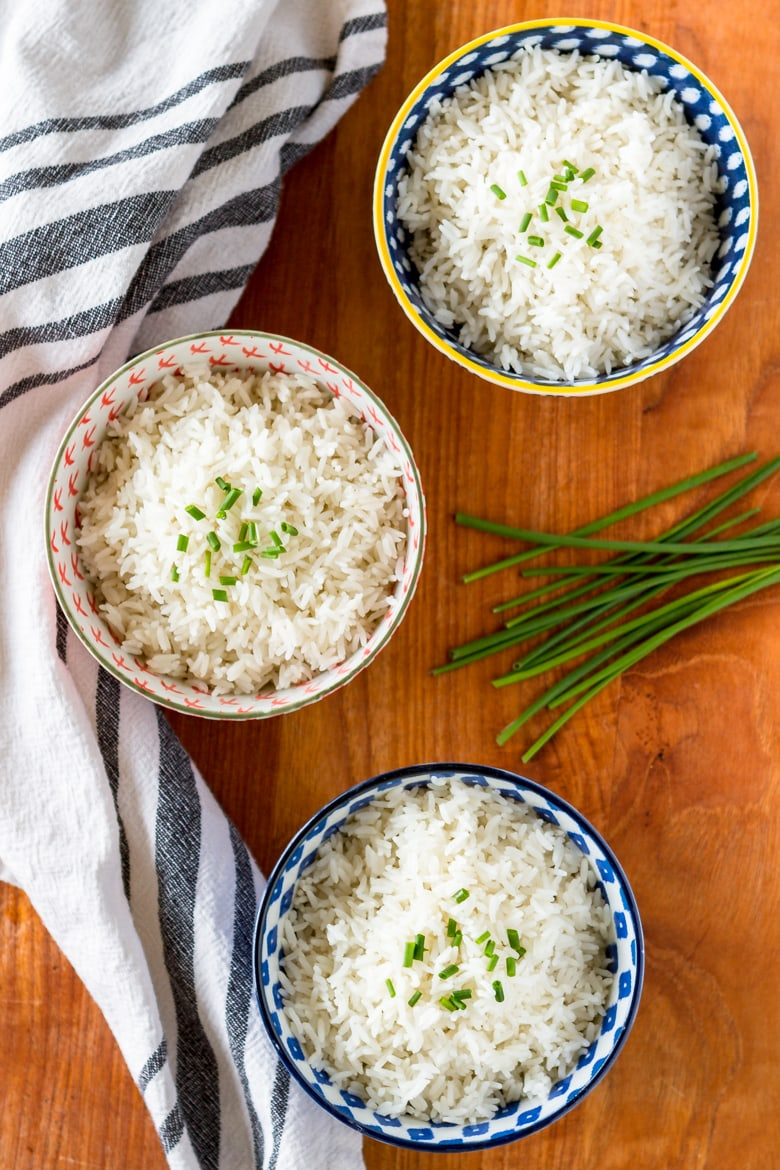 coconut rice recipe served in 3 bowls topped with chives