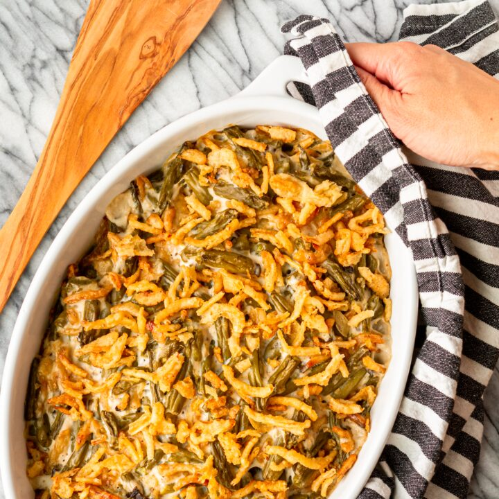 3-ingredient easy green bean casserole recipe in an oval white staub baking dish