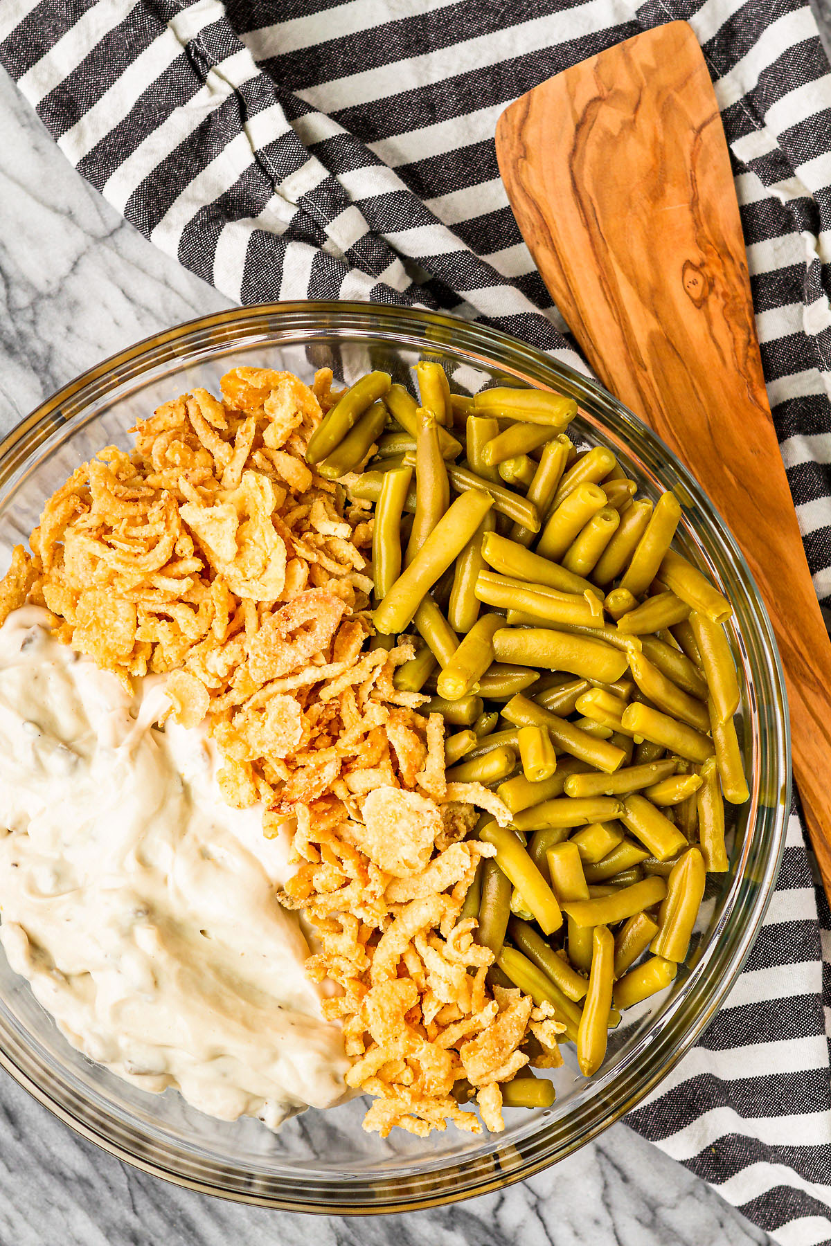 simple green bean casserole ingredients in a clear glass bowl