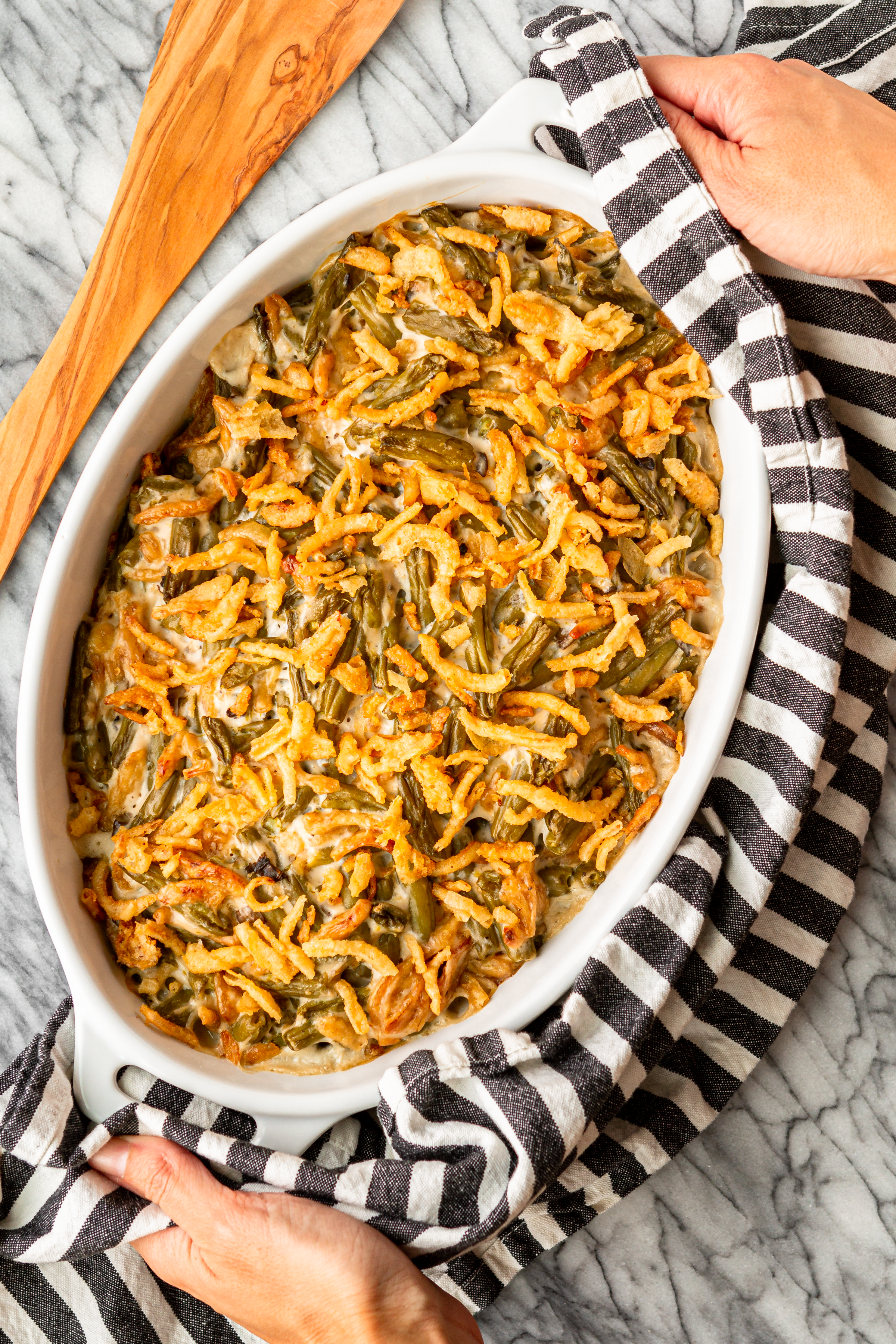 easy green bean casserole recipe in an oval white staub baking dish