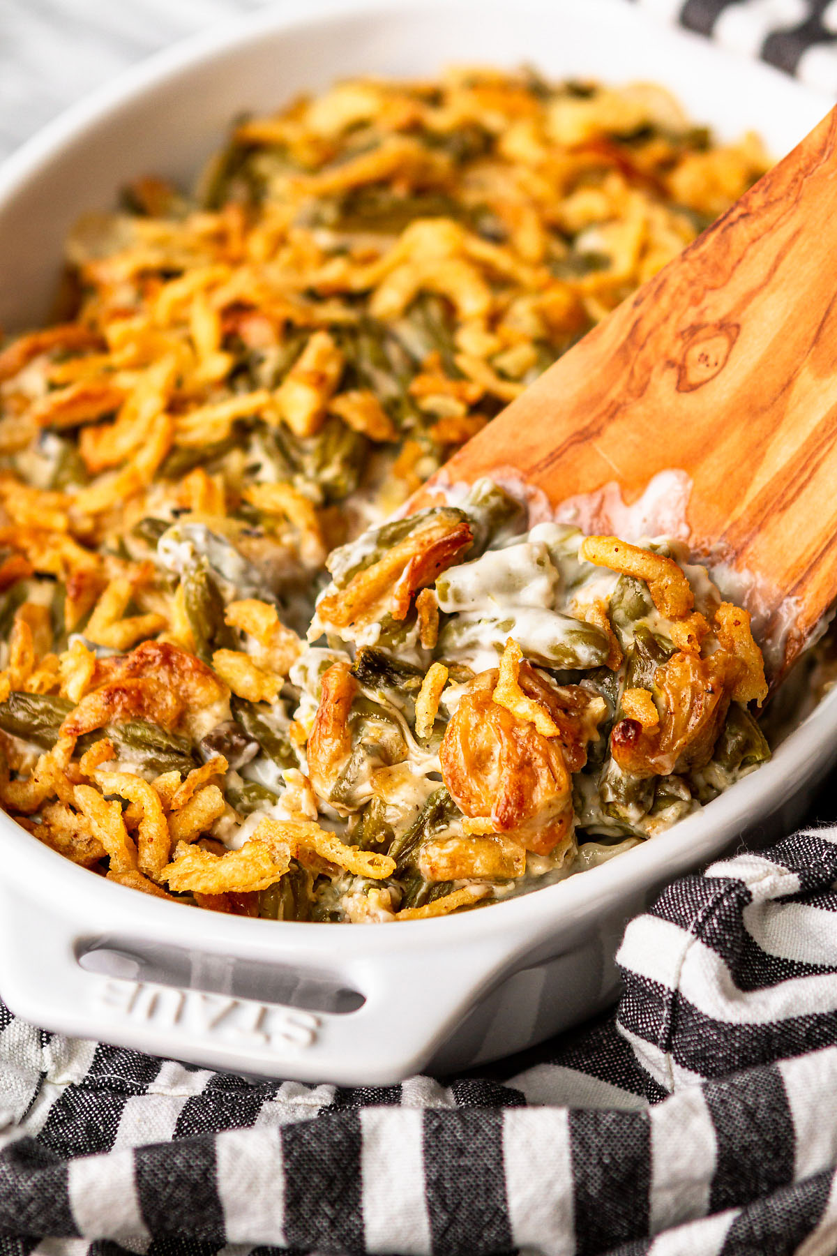 easy green bean casserole with a wooden spatula