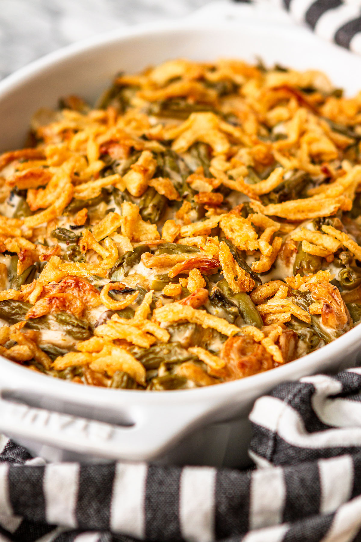 simple green bean casserole in a white baking dish