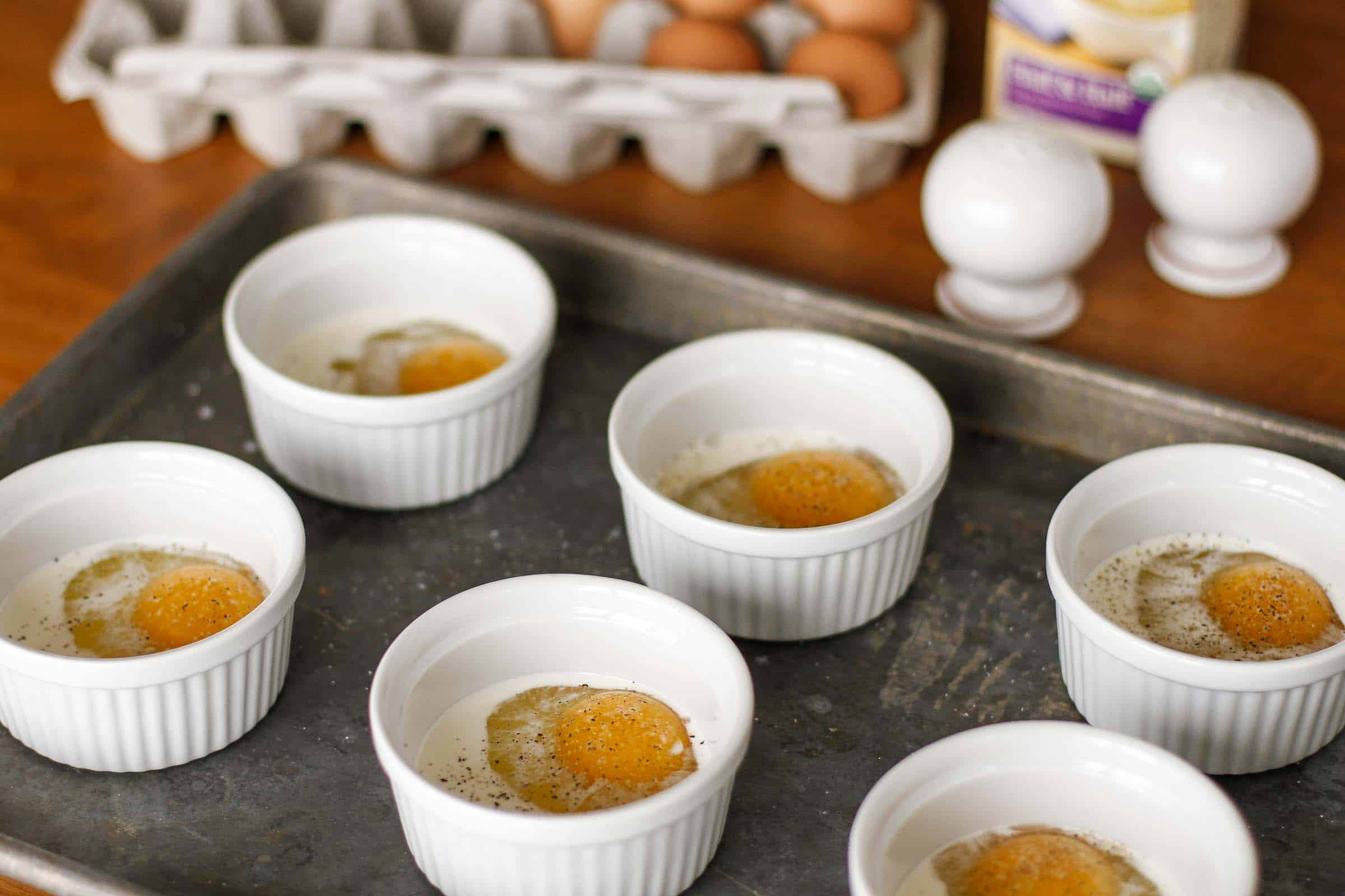 Basic Baked Eggs Recipe -- this baked eggs (also known as shirred eggs) is a fabulously simple and easy way to cook multiple servings of eggs all at once! | unsophisticook.com