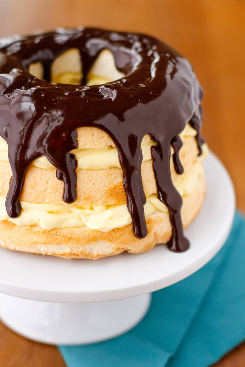 Boston Cream Pie Cake -- this yummy layered Boston cream pie dessert recipe looks like it took hours to prepare but can be party ready in under 15 minutes!   via @unsophisticook on unsophisticook.com