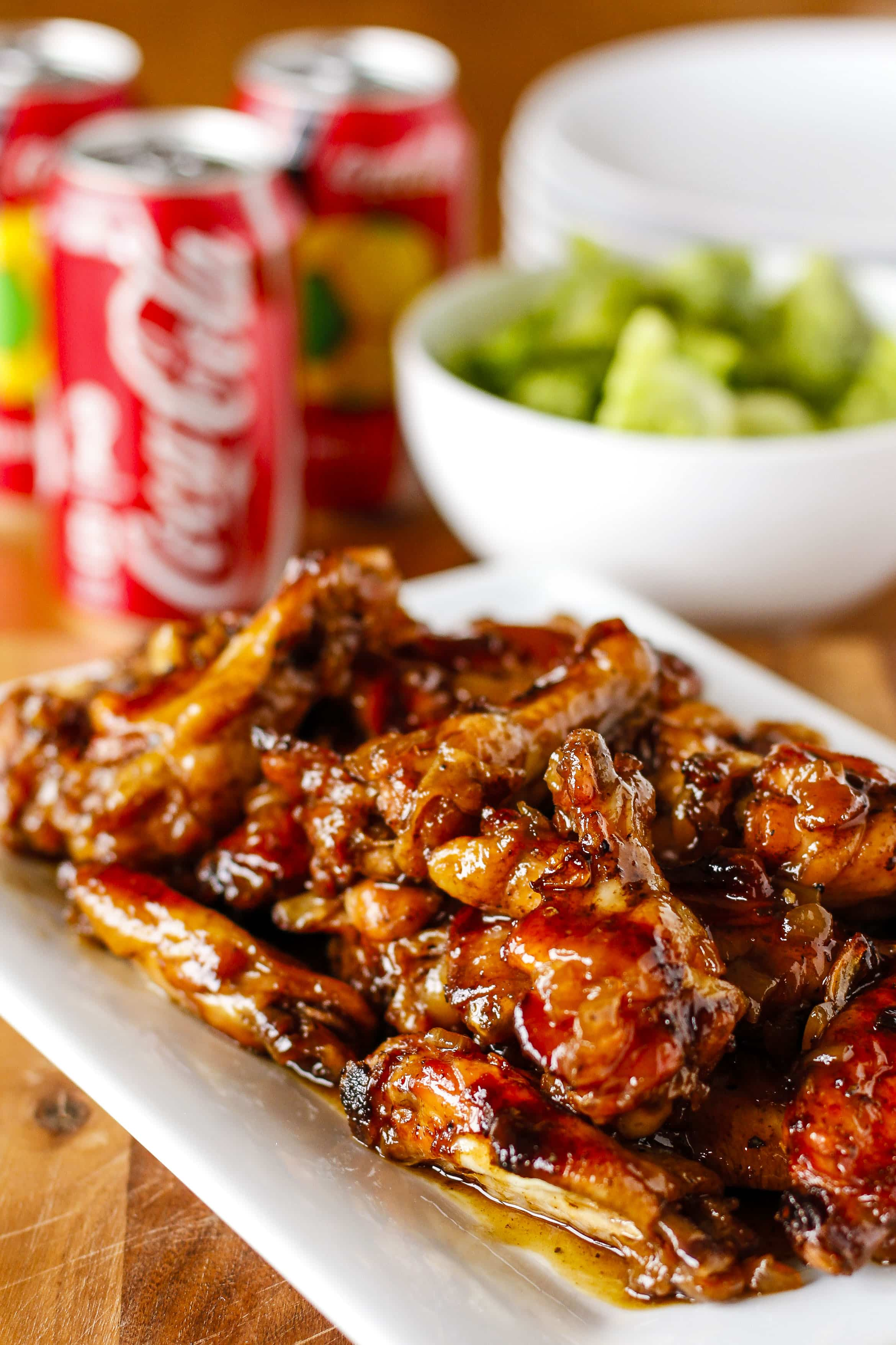 Baked Chicken Wings -- don't miss these crispy Coca-Cola baked chicken wings smothered in a delicious sweet and tangy sauce, PERFECT for game day and beyond! | unsophisticook.com