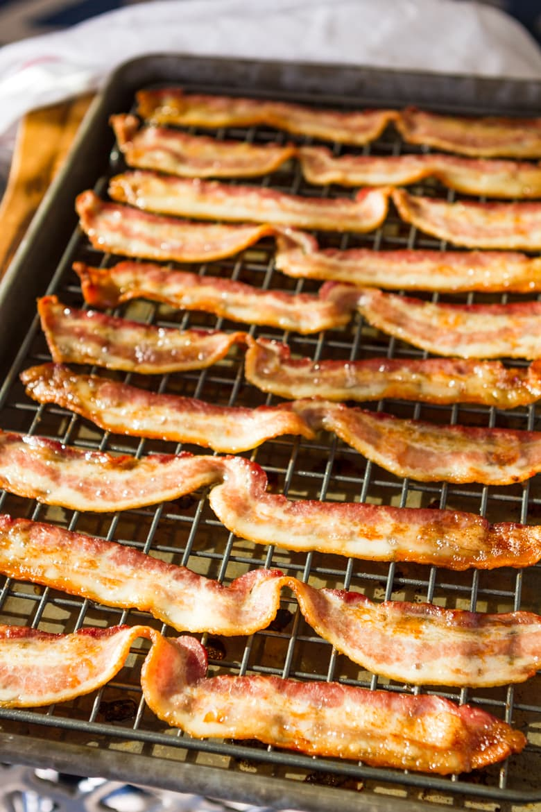 How To Bake Bacon -- baked bacon is, hands down, the easiest way to get perfectly crispy and delicious bacon with the least amount of mess. Makes big batches a cinch! | via @unsophisticook on unsophisticook.com