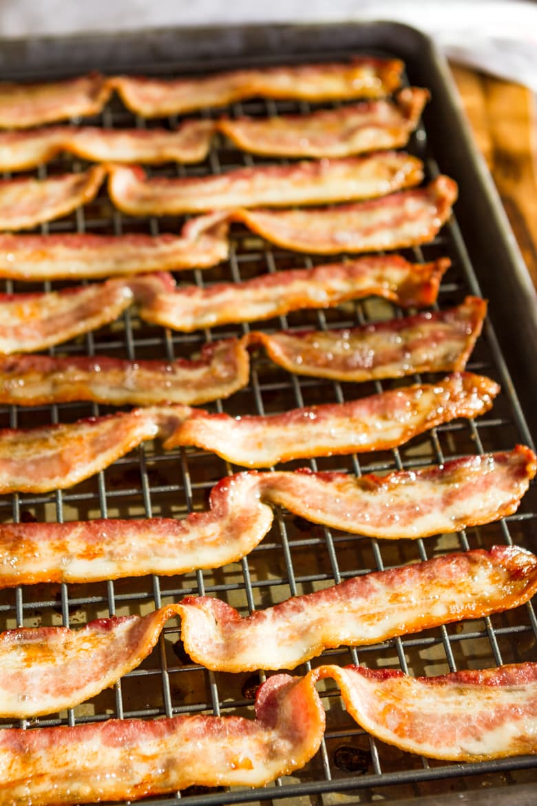 oven baked bacon on a cooling rack set on a baking sheet