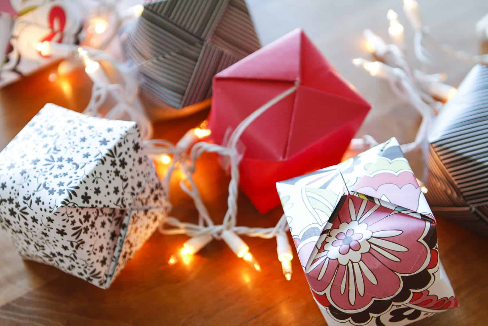 origami lights made with white light strand and scrapbook paper