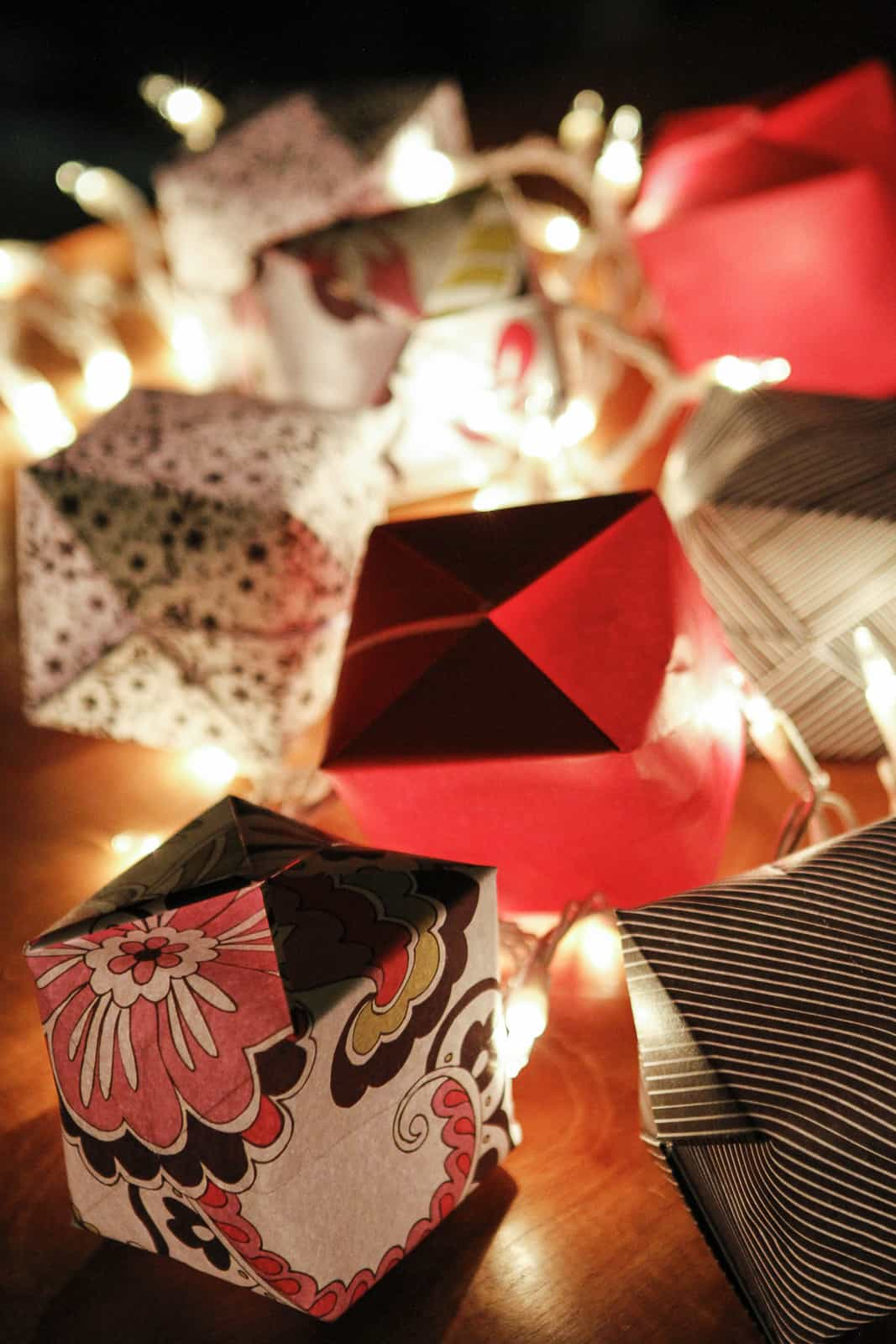 origami lights with scrapbook paper lit up at night