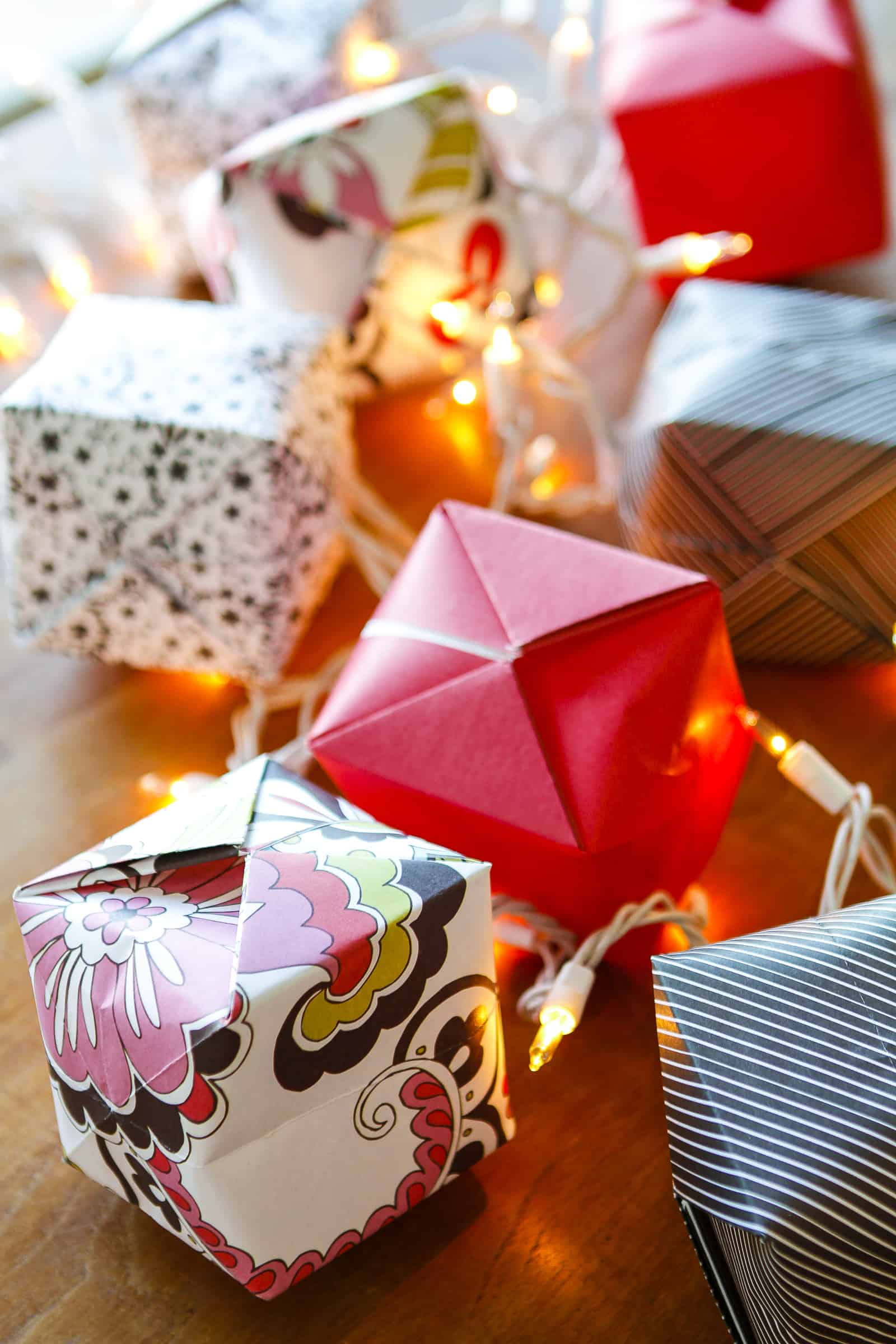 Origami Lights -- transform the classic Chinese water bomb into origami light covers to create these gorgeous origami string lights, a beautiful and festive lighting option! Not just for Chinese New Year, they're a great option for indoor or outdoor parties, weddings, baby showers, Christmas, you name it... | paper crafts | easy crafts | origami water bomb instructions | paper balloon lanterns | party lights | find the tutorial on unsophisticook.com