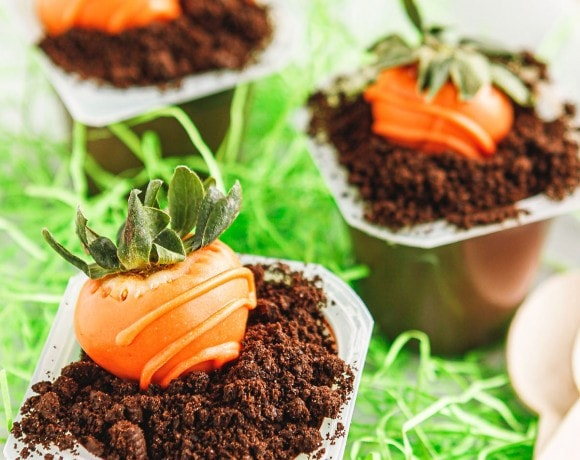 easter dirt cups made with snack size chocolate pudding and crushed oreo cookies