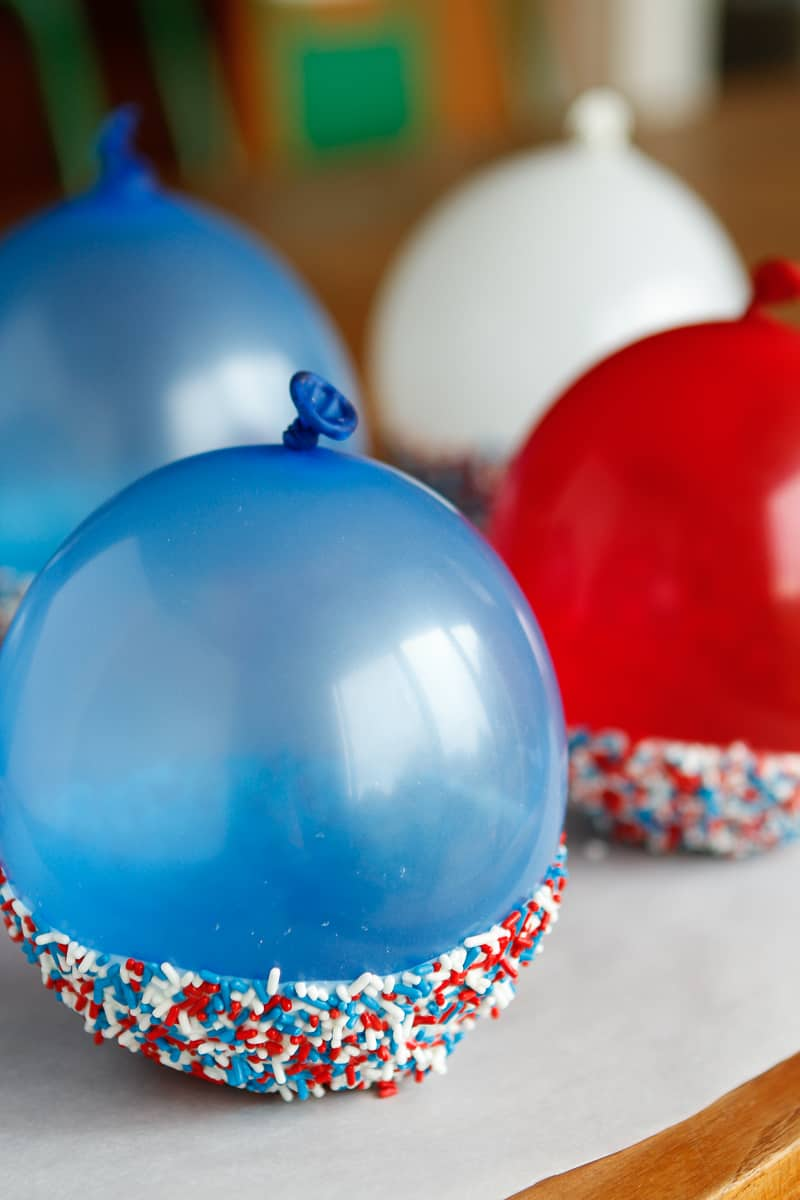 Chocolate Bowls -- we've all seen those fancy chocolate balloon bowls on TV... Take them to the next level by coating them with your favorite colored sprinkles, so adorable and festive for any party! | via @unsophisticook on unsophisticook.com