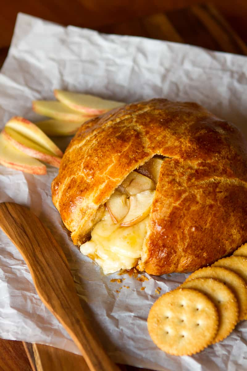 Baked Brie Appetizer -- this amazing baked Brie recipe features warm, melty Brie cheese, tender apples and sweet brown sugar, all wrapped up in buttery, delicious crescent dinner roll dough! | via @unsophisticook on unsophisticook.com