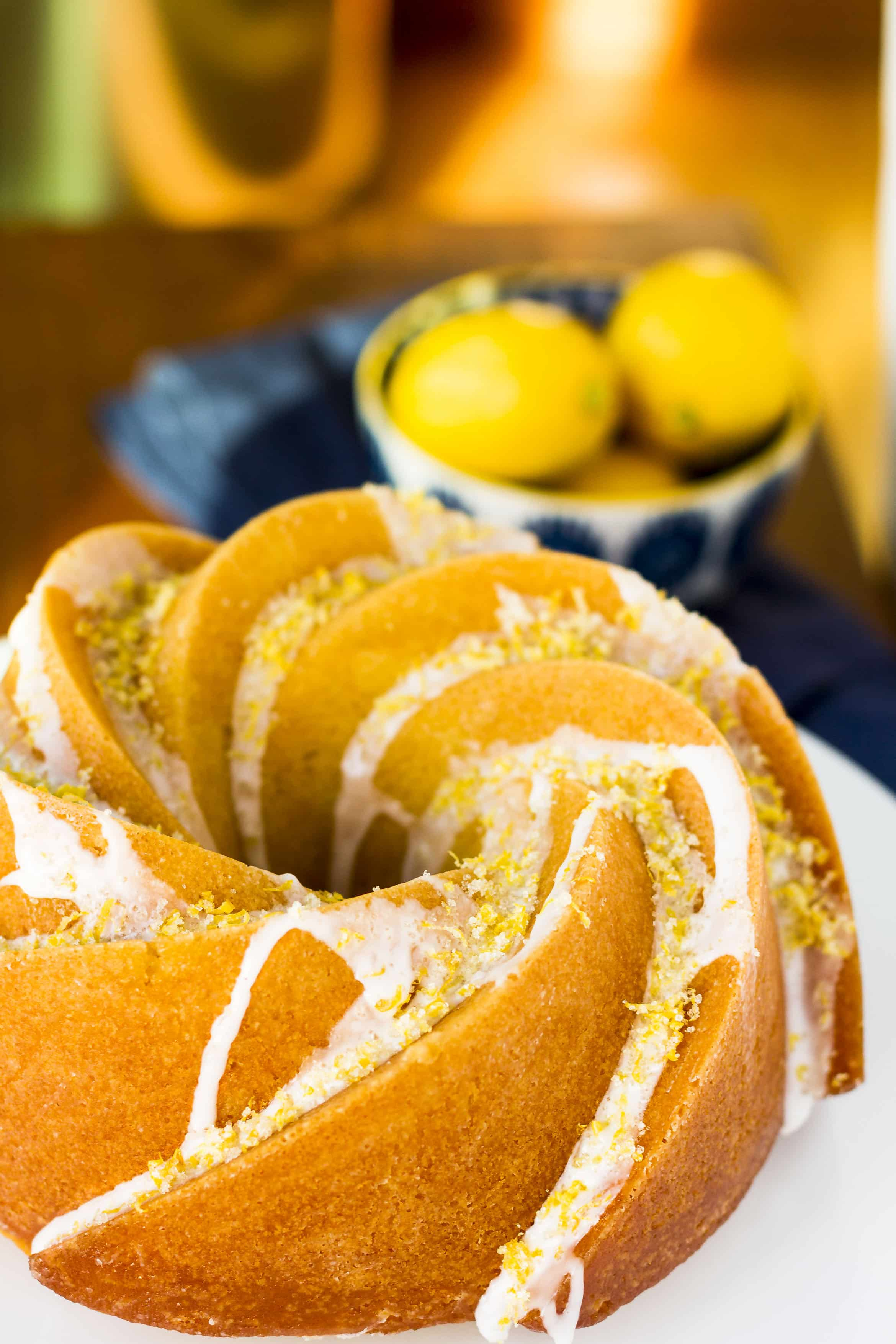 Triple Lemon Bundt Cake -- luscious lemon butter cake infused with lemon syrup, drizzled with a lemon glaze and topped off with a sprinkling of lemon sugar = HEAVEN!!! A to-die-for bundt cake recipe... | unsophisticook.com