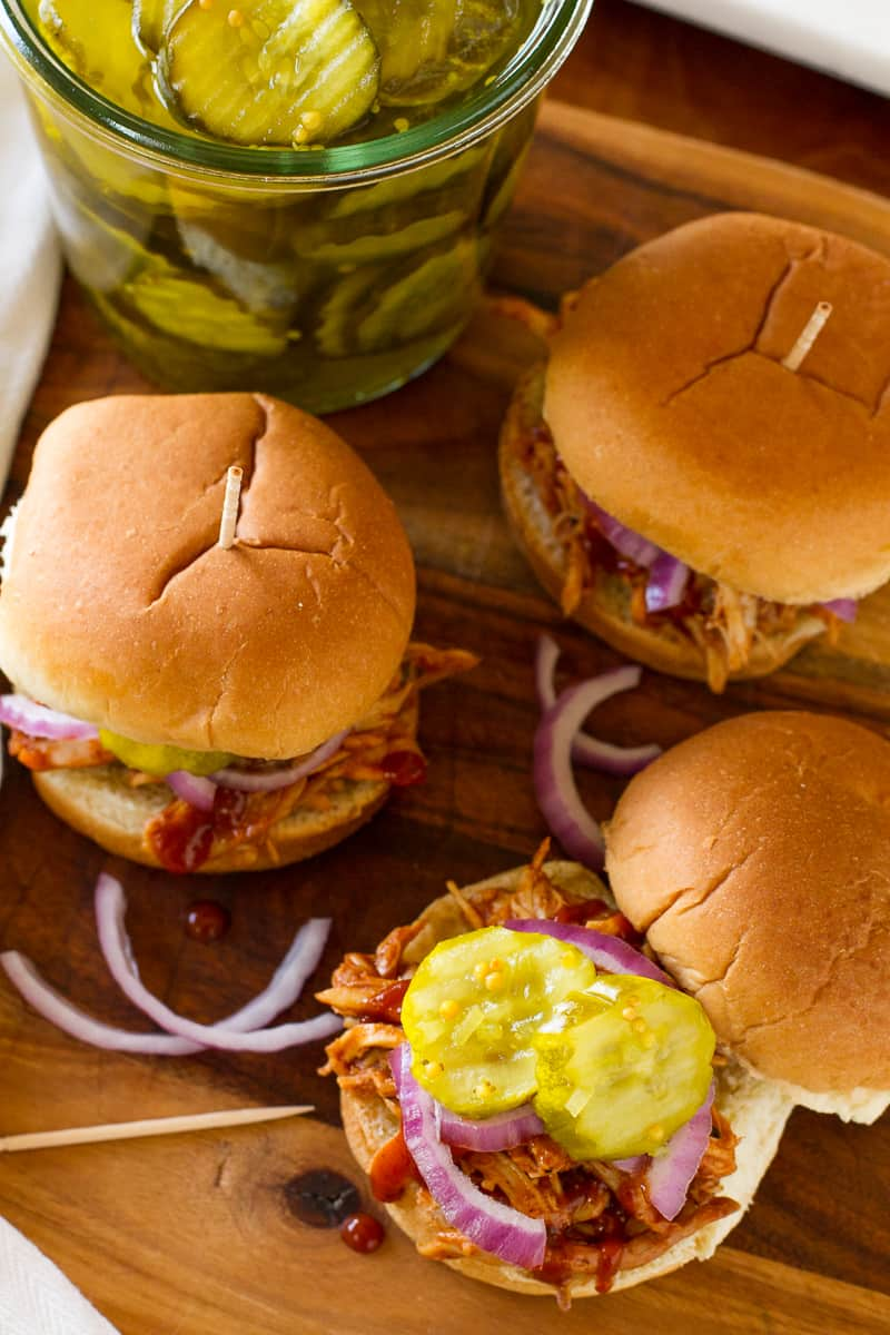 BBQ Shredded Chicken Sliders -- these chicken sliders are the perfect quick and simple weeknight meal, thanks to shredded rotisserie chicken and a bottle of your favorite barbecue sauce! Top them with some thinly sliced red onion and sweet pickles, yum… | via @unsophisticook on unsophisticook.com