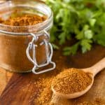 homemade taco seasoning all purpose spice mix in a jar with a measuring spoon