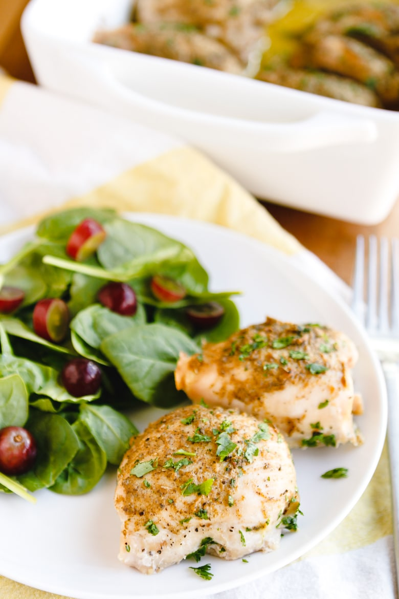 baked chicken thighs with a simple salad