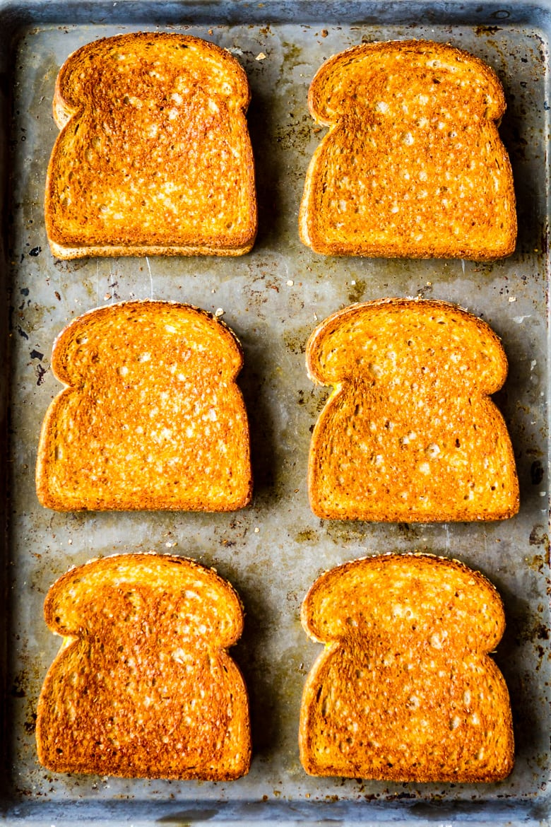 grilled cheese in the oven 6 grilled cheese sandwiches on a baking sheet