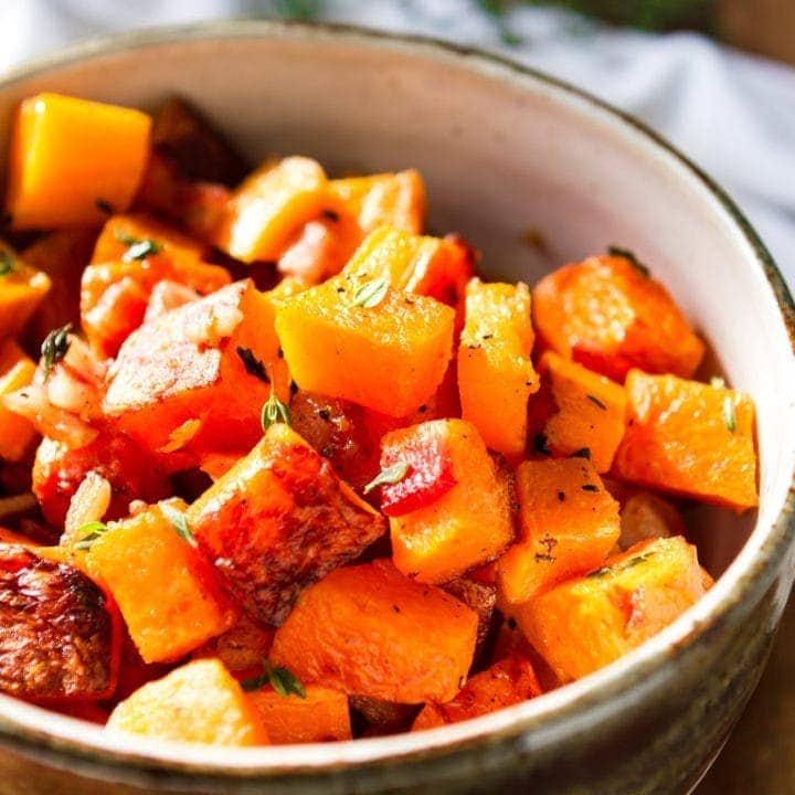 3-ingredient oven roasted butternut squash recipe with bacon in a handmade bowl