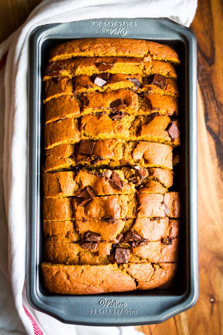 pumpkin chocolate chip bread sliced in a metal loaf pan