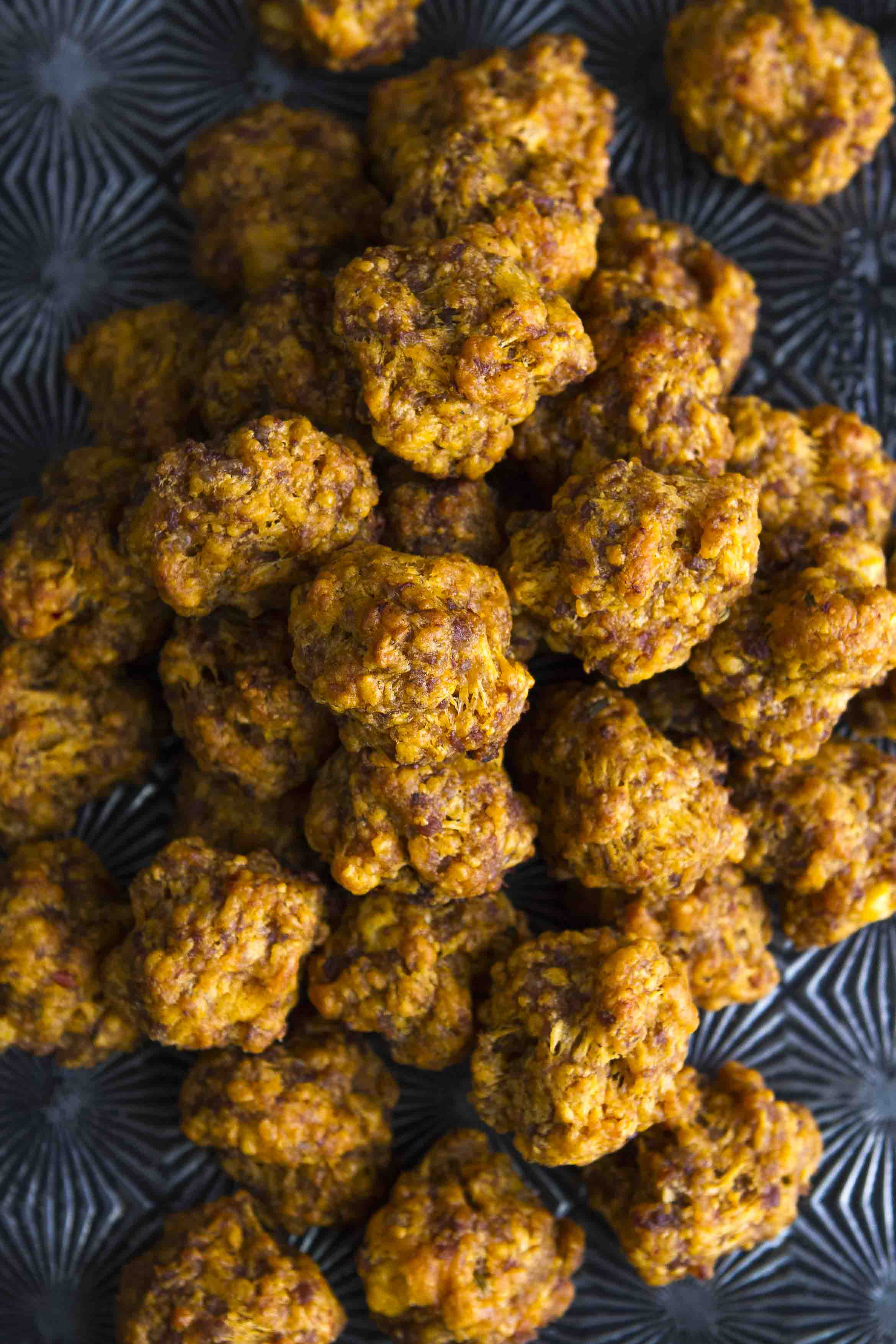 Sriracha Sausage Cheddar Balls -- a kicked up take on the Southern classic sausage cheddar balls recipe… These easy sausage balls are made from scratch and totally kid approved, a MUST for game day!   unsophisticook.com