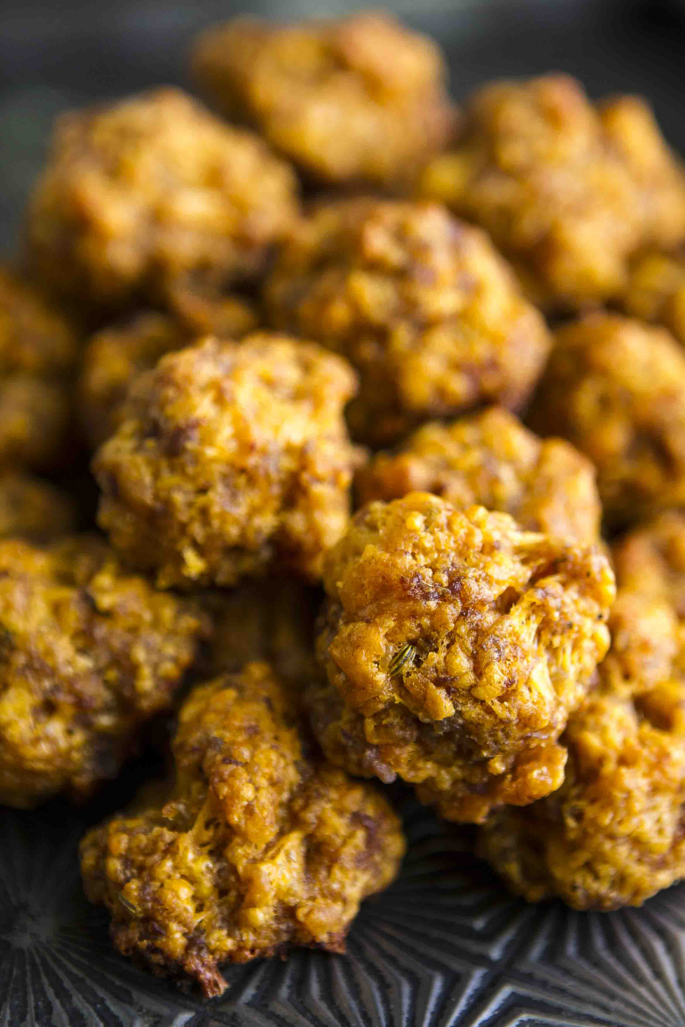 Sriracha Sausage Cheddar Balls -- a kicked up take on the Southern classic sausage cheddar balls recipe… These easy sausage balls are made from scratch and totally kid approved, a MUST for game day! | unsophisticook.com