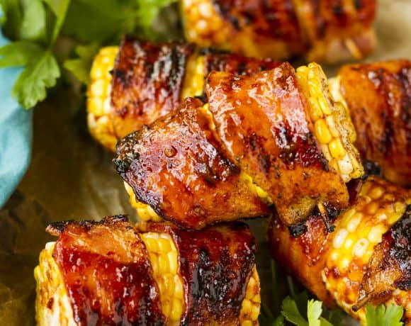 Sweet & Spicy Grilled Bacon Wrapped Corn On The Cob