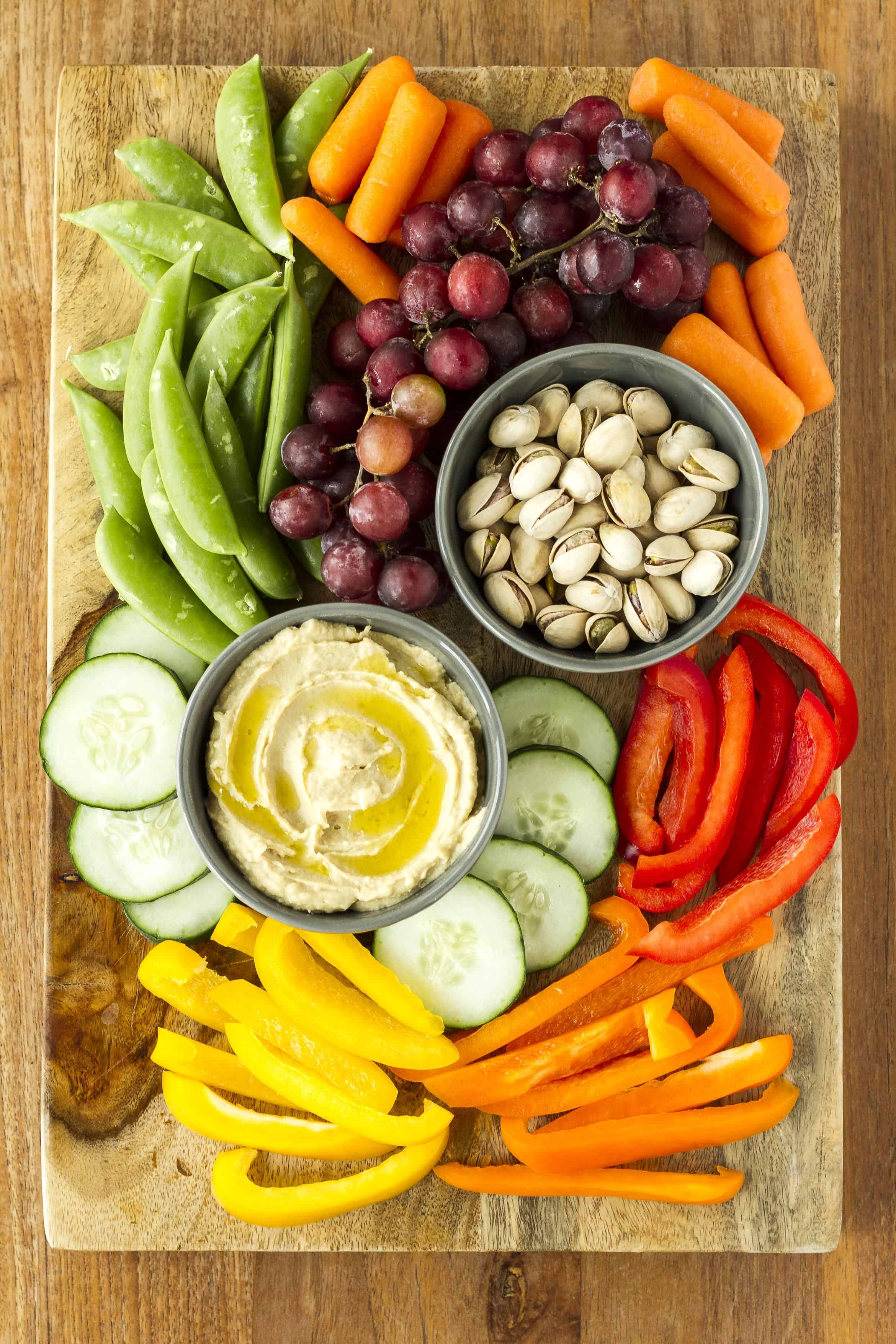 Easy Entertaining Hummus Platter -- this simple and easy hummus platter takes less than five minutes to put together and has something for everyone at your gathering… Nuts add a bit of saltiness and grapes add some sweetness, then fill the rest up with lots of colorful fresh seasonal veggies! | hummus platter idea | simple hummus platter | hummus platter veggie tray | hummus platter appetizer | find the details on unsophisticook.com