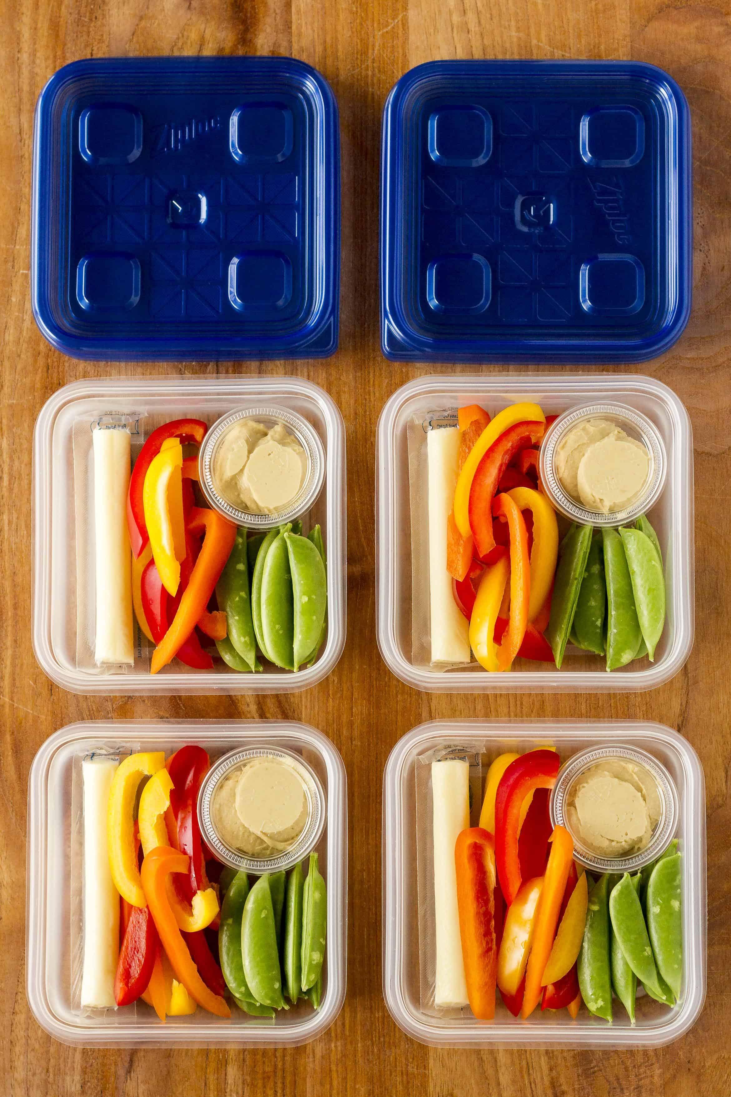 Simple Veggies & Hummus Snack Box -- this easy hummus snack idea is the ideal meal prep snack for on-the-go families. Pair lots of fresh veggies with perfectly portioned mini hummus cups, and you can grab a budget-friendly healthy snack any time you need it! | hummus snacks | hummus snack ideas | hummus snack healthy | hummus snack what to eat | hummus snack sabra | find the details on unsophisticook.com