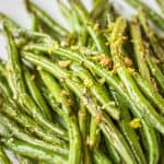 Sautéed Green Beans with Garlic -- adding a little extra raw minced garlic to these sautéed green beans at the end of cooking gives them an extra unexpected punch of flavor! | fresh green beans | green beans recipe | healthy green beans | easy green beans | how to cook green beans | find the recipe on unsophisticook.com