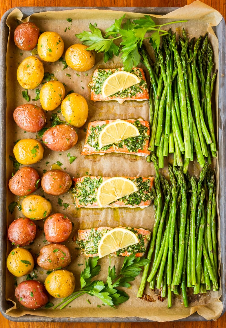 sheet pan salmon and asparagus and potatoes with parsley garlic butter