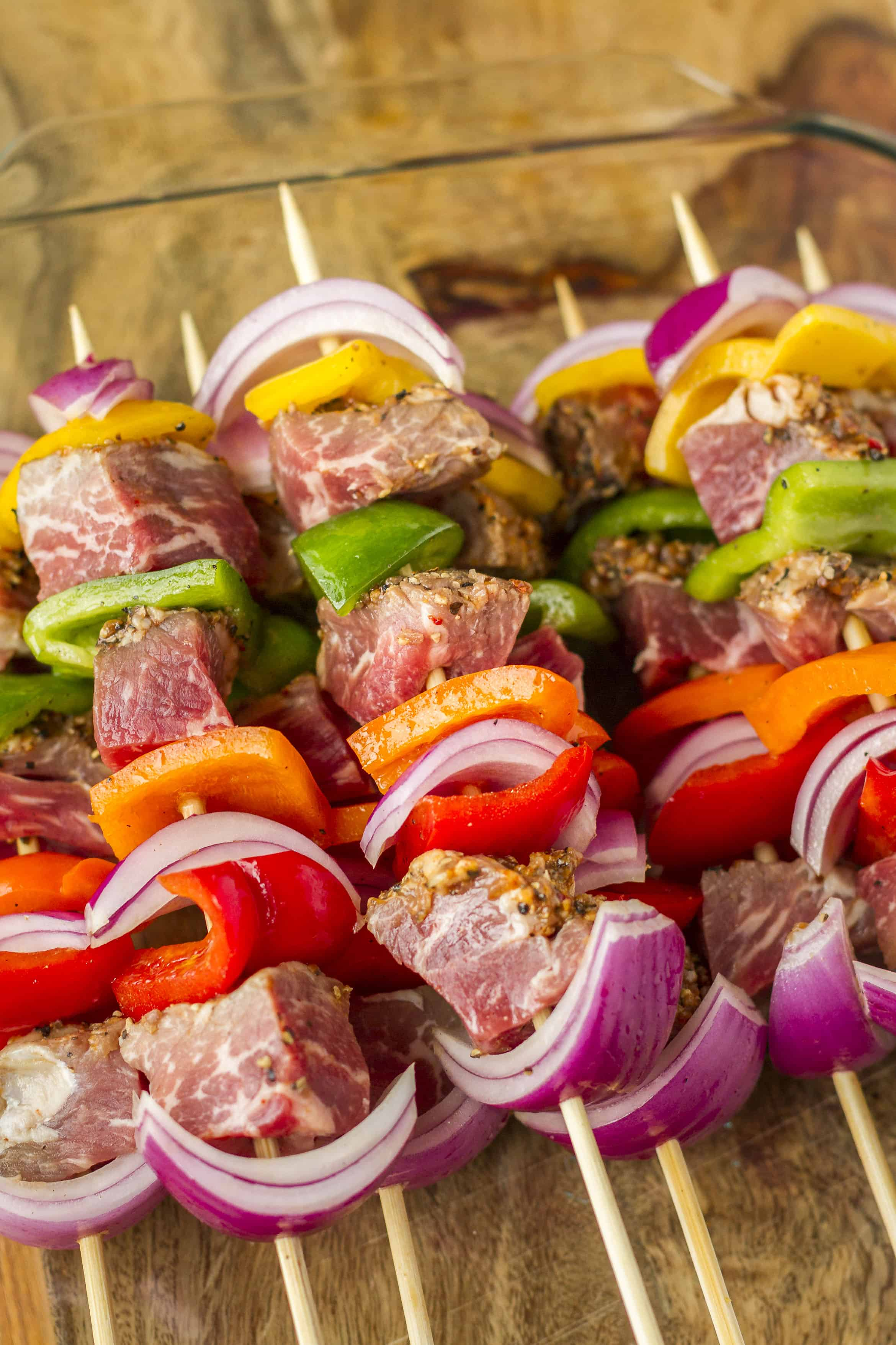 Tri-Tip Beef Kabobs -- Try these delicious tri-tip beef kabobs at your next cookout! Chunks of marinated tri-tip, with colorful red onions and bell peppers, will have your guests lining up for more! | kabobs on the grill | steak kabobs | kabobs recipe | kebabs recipe | get the recipe on unsophisticook.com