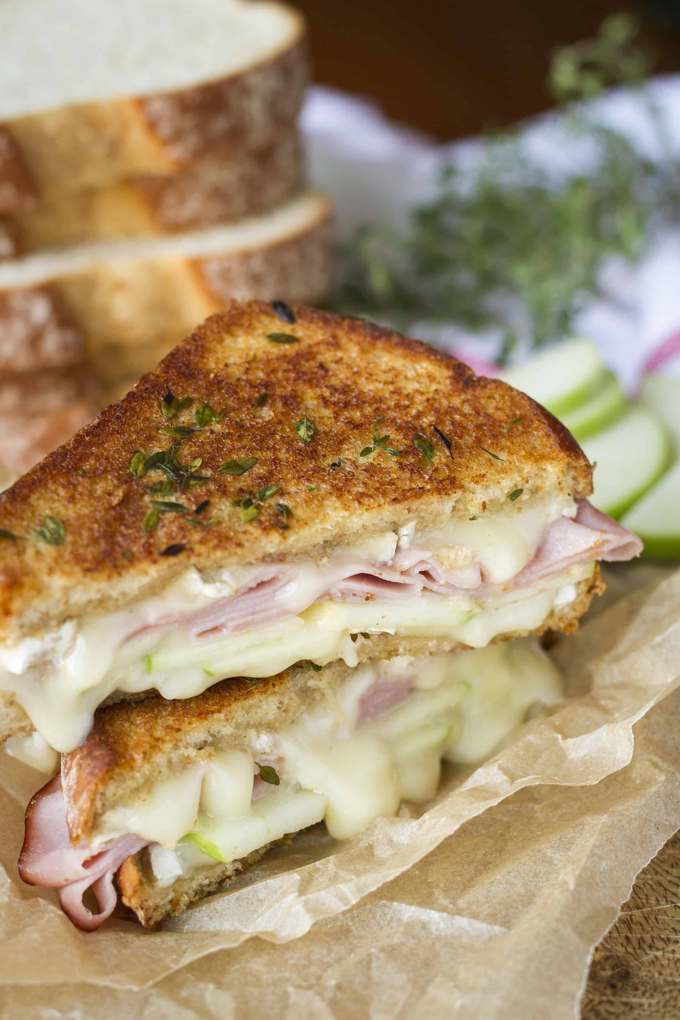 Apple Ham & Brie Grilled Cheese -- this decadent grilled cheese is packed with flavor! Thick bread slathered in fresh thyme butter and filled with green apples, smoked ham, and brie cheese, all drizzled with a touch of honey… | brie grilled cheese | apple brie grilled cheese | honey brie grilled cheese | brie grilled cheese recipe | find the recipe on unsophisticook.com