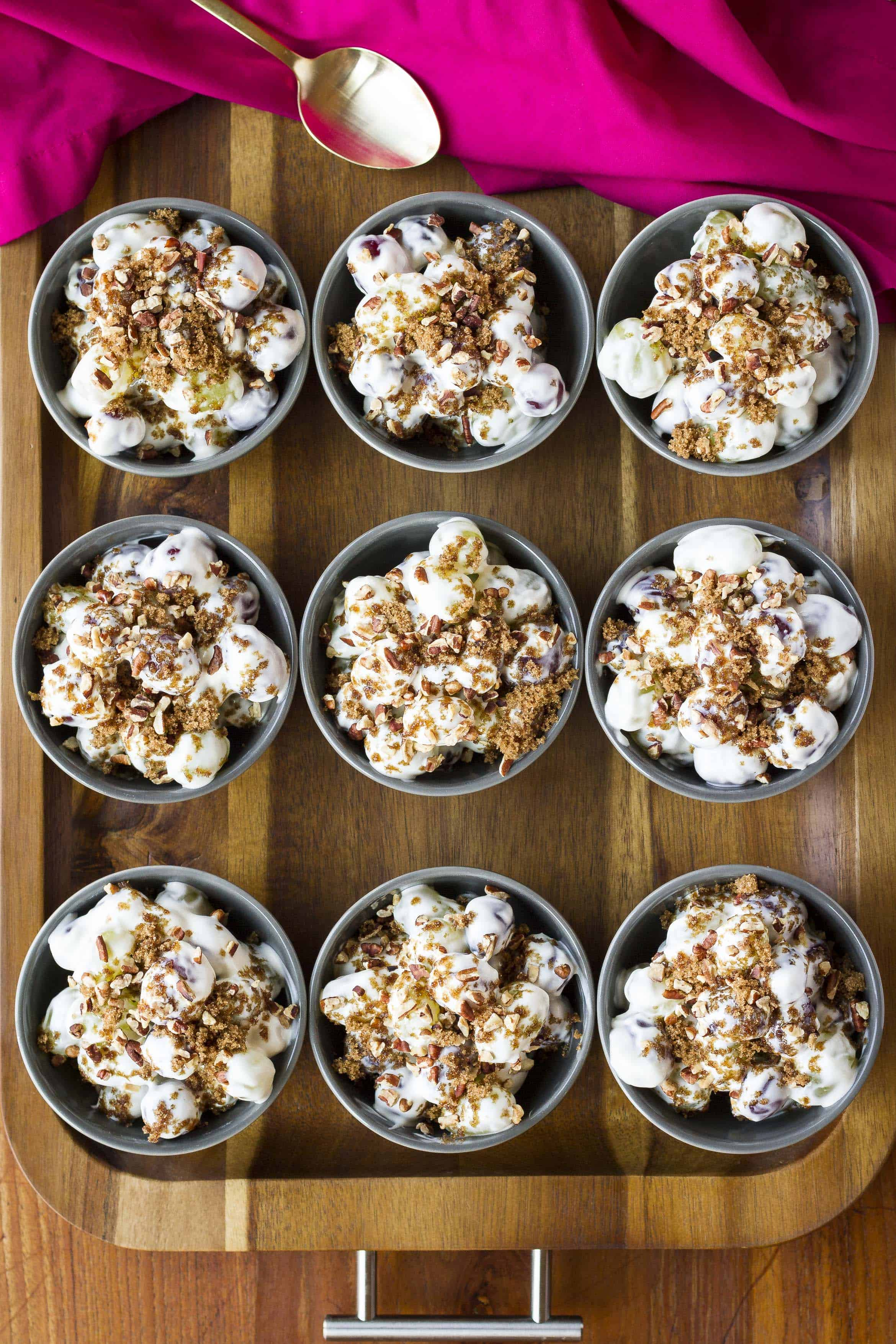 Creamy Grape Salad with Toasted Pecans -- it's never the wrong time to bring this grape salad to a gathering! Plump, juicy grapes folded into a cool, creamy mixture of cream cheese and sour cream, all topped off with dark brown sugar and crunchy toasted pecans… | grape salad recipe | grape salad with cream cheese | grape salad with brown sugar | easy grape salad | find the recipe on unsophisticook.com
