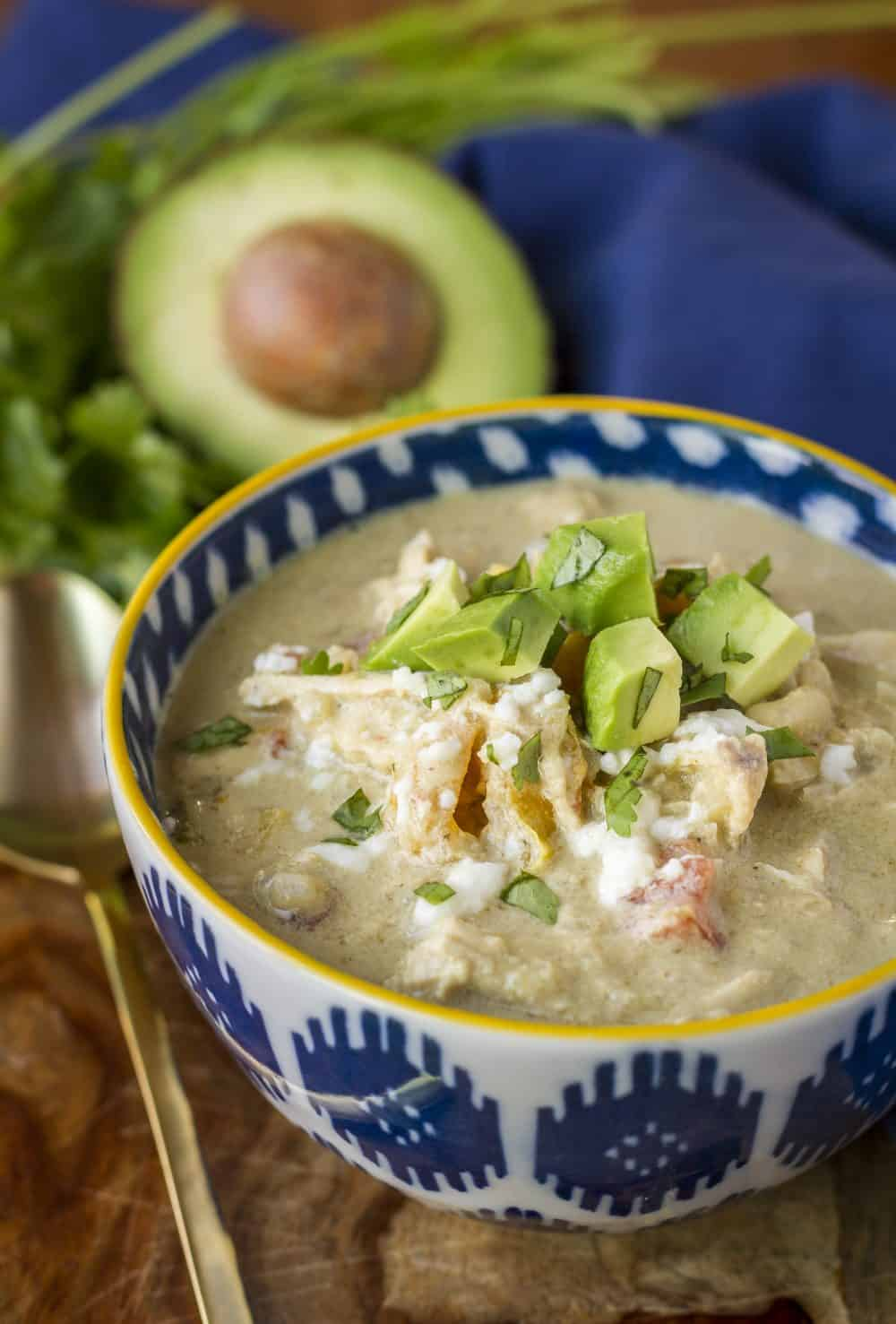 Creamy Verde Chicken Chili -- this delicious low carb chicken chili is packed with flavor, yet has only one net carb per serving… Make it in your slow cooker or your Instant Pot for dinner tonight! | skinny chicken chili | crockpot chicken chili | chicken chili recipe | healthy chicken chili | cream cheese chicken chili | find the recipe on unsophisticook.com