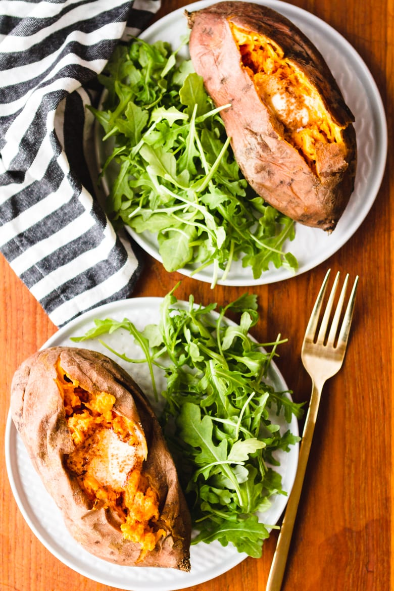 pressure cooker sweet potatoes on a plate with fresh arugula