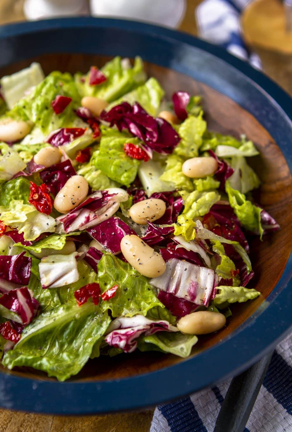 vegan Italian chopped salad with radicchio, romaine, cannellini beans, and sun-dried tomatoes