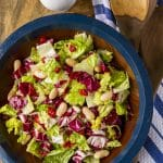 Italian chopped salad recipe made with just 4 ingredients served in a wooden salad bowl with blue rim