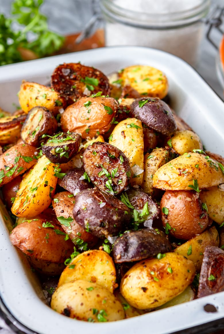 ranch potatoes in a black and white enamel dish