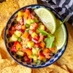 fresh pineapple salsa recipe in a blue and white bowl with tortilla chips