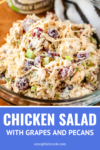 chicken salad with grapes and pecans in a glass bowl