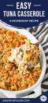 easy tuna casserole with egg noodles in a white ceramic baking dish being scooped out with a silver spoon
