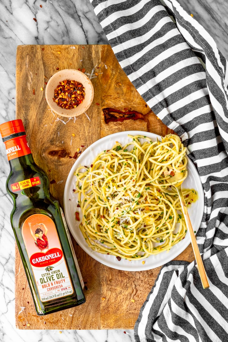 olive oil pasta sauce ingredients on a wooden cutting board