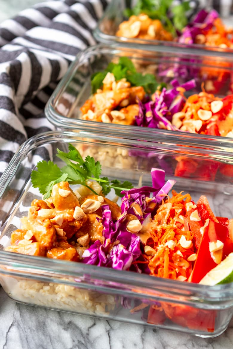 peanut sauce chicken meal prep bowls with brown rice and colorful fresh veggies
